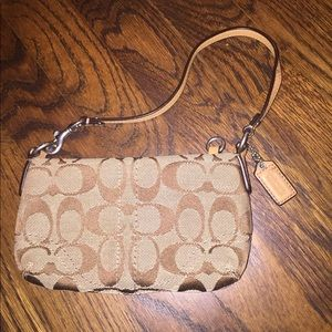 Never used brown Coach wristlet